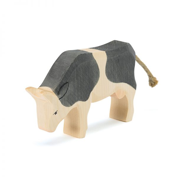 Figura legno mucca pezzata che mangia- Ostheimer